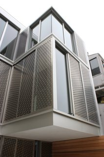 A Historic Victorian in San Francisco Is Meticulously Transformed Into a Modern Family Home - Photo 21 of 26 - The home's dramatic rear facade is composed of perforated metal screens by Flynn & Enslow, which are attached to Fleetwood windows. The second-floor bump out is cantilevered with no structural post below.