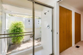 A Midcentury Home For Sale in L.A. That Was Originally Designed For a WWII Pilot - Photo 10 of 16 - The indoor/outdoor shower is also original.