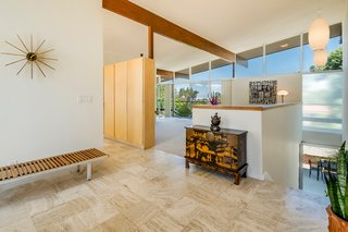 A Midcentury Home For Sale in L.A. That Was Originally Designed For a WWII Pilot - Photo 7 of 16 - Original built-ins act as a visual divider in the living space.