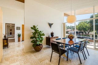 A Midcentury Home For Sale in L.A. That Was Originally Designed For a WWII Pilot - Photo 4 of 16 - The partially-enclosed dining room faces the front of the home, where the expansive porch wraps around the entire property.