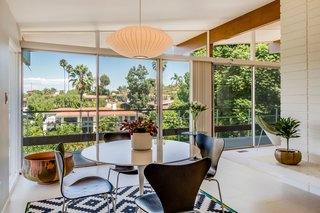A Midcentury Home For Sale in L.A. That Was Originally Designed For a WWII Pilot - Photo 3 of 16 - Adjacent to the kitchen is an eat-in dining space that's flooded with natural light.