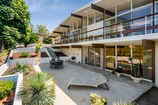 A Midcentury Home For Sale in L.A. That Was Originally Designed For a WWII Pilot - Photo 13 of 16 - Drought-tolerant landscaping accents the backyard. The rear elevation features impressive spans of glass, original to the home.