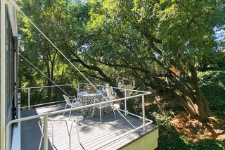 An Amazing Tree-Covered Glass House For Sale in the Berkeley Hills - Photo 11 of 20 - The deck is supported by a large beam that's bolted and tied to the main part of the house with steel cables.