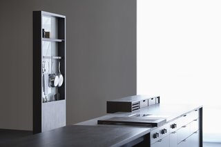 Henrybuilt's Systems Instantly Upgrade Unused Space - Photo 8 of 9 - Storage options for the 'working side' include shelves, pot racks, integrated outlets, knife storage, and recessed areas for things like keys.