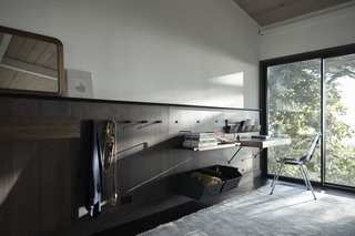 """Henrybuilt's Systems Instantly Upgrade Unused Space - Photo 2 of 9 - The panel-based storage system creates a feeling of refined openness while adding a high-quality, finished look.<cite data-placeholder=""""true"""">Add credit</cite>"""