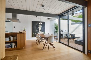 Check Out 2 Beautifully Renovated Eichlers For Sale in San Francisco - Photo 4 of 22 - Giant sliding glass doors from Fleetwood connect the dining room to the atrium.