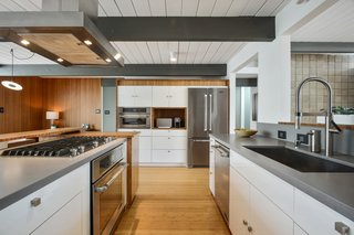 Check Out 2 Beautifully Renovated Eichlers For Sale in San Francisco - Photo 6 of 22 - Original beams and painted wood ceiling planks are featured throughout the public spaces.