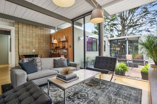 Check Out 2 Beautifully Renovated Eichlers For Sale in San Francisco - Photo 7 of 22 - The original cinder-block fireplace anchors the living room.