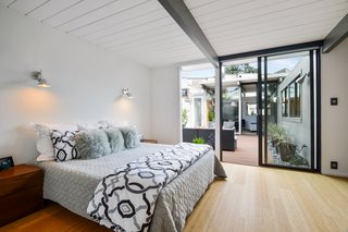 Check Out 2 Beautifully Renovated Eichlers For Sale in San Francisco - Photo 10 of 22 - The courtyard-adjacent master bedroom enjoys visual and functional integration with the outdoors.