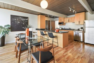 Check Out 2 Beautifully Renovated Eichlers For Sale in San Francisco - Photo 16 of 22 - The kitchen received a recent upgrade, while an original globe light hangs above the dining area.