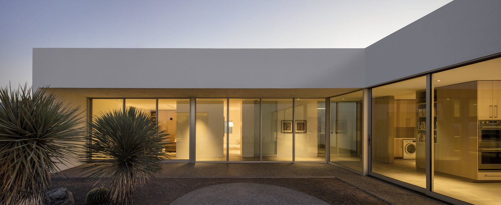 Tucsonu0027s Courtyard House by HK Associates features giant floor-to-ceiling fixed & Photo 2 of 6 in How to Pick the Most Energy-Efficient Windows and ... pezcame.com