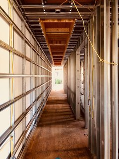 Dan Brunn Architecture and Dwell Break Ground on Bridge House in L.A. - Photo 6 of 6 - With the help of BONE Structure's steel framework, electrical wires can be easily routed through pre-cut openings.