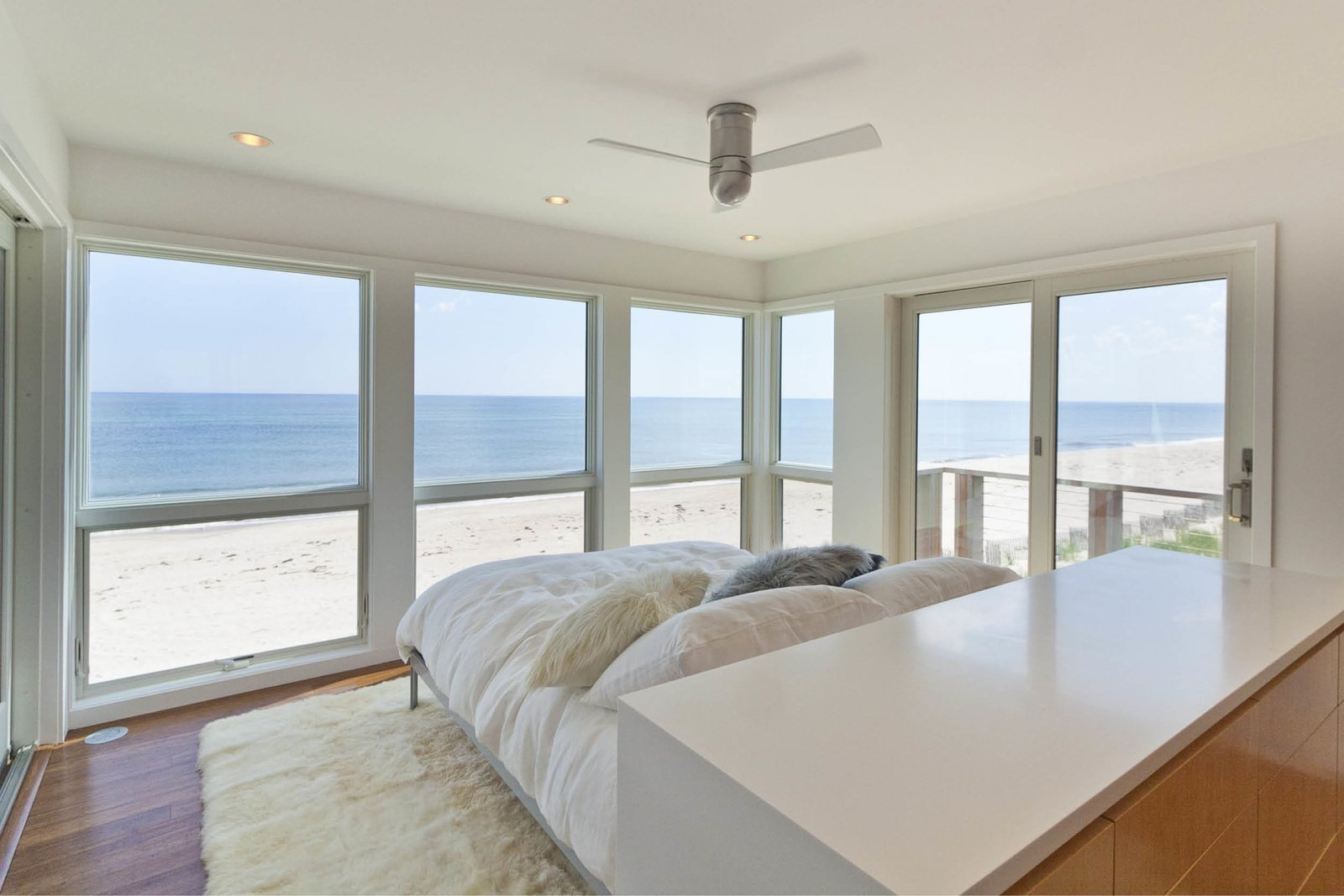 Master bedroom Tagged: Bedroom, Bed, Storage, Ceiling, and Medium Hardwood.  Best Bedroom Storage Ceiling Photos from Dune Road Beach House
