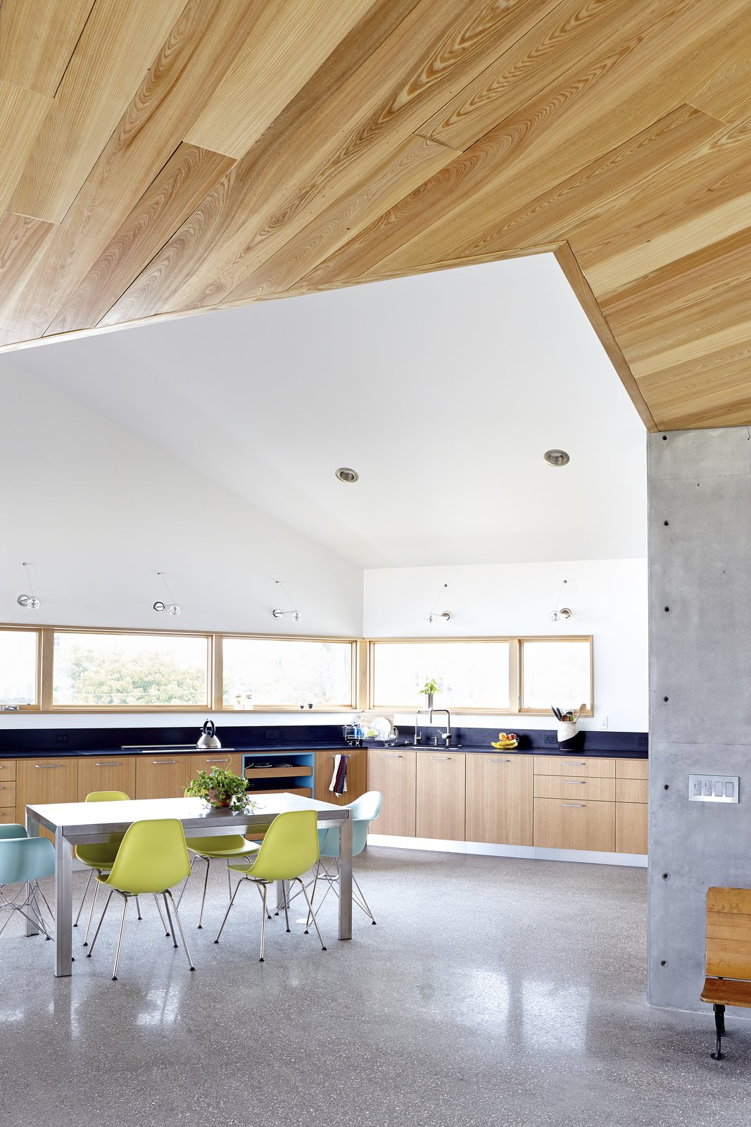 Tagged: Kitchen, Wood Cabinet, and Concrete Floor.  Seagrape House by Traction Architecture