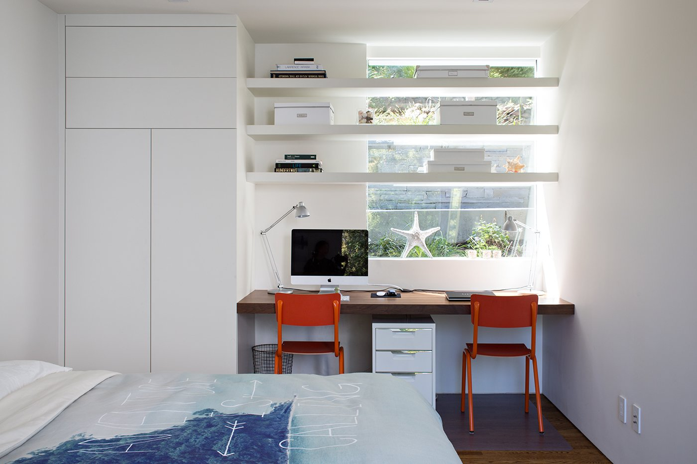 Minimal Modern Addition  Sebastian and Tanja DiGrande's quest for natural light and open, modern design led them to Klopf Architecture in San Francisco. Working hand-in-hand with homeowner/designer Tanja DiGrande, Klopf collaborated on a modern addition to the rear of a traditional-style home. The idea was to depart from the original style completely to draw a distinction between the original house and any later additions, as well as observe a very minimal, clean, gallery-like modern style against which changing daylight, art, furniture, and of course the people provide the color and motion.  With its dark gray stuccoed walls, dark steel railing, and floor-to-ceiling windows, the exterior of the addition is at the same time an open, modern box as well as a receding volume that acts almost as a backdrop for the house, receding visually out of respect for the original home. From the interior, windows bring in nature and views from all around the lush property. They also allow views of the original house. Up on the roof deck the views magnify. The owners use a boom and crank to bring up food and drinks when entertaining!  Inside, the simple clean-lined spaces showcase the couple's minimal, modern taste. The open bathroom epitomizes the clean, minimal style of the addition. On the exterior, steel elements bring a more industrial modern feeling to the addition from the rear.