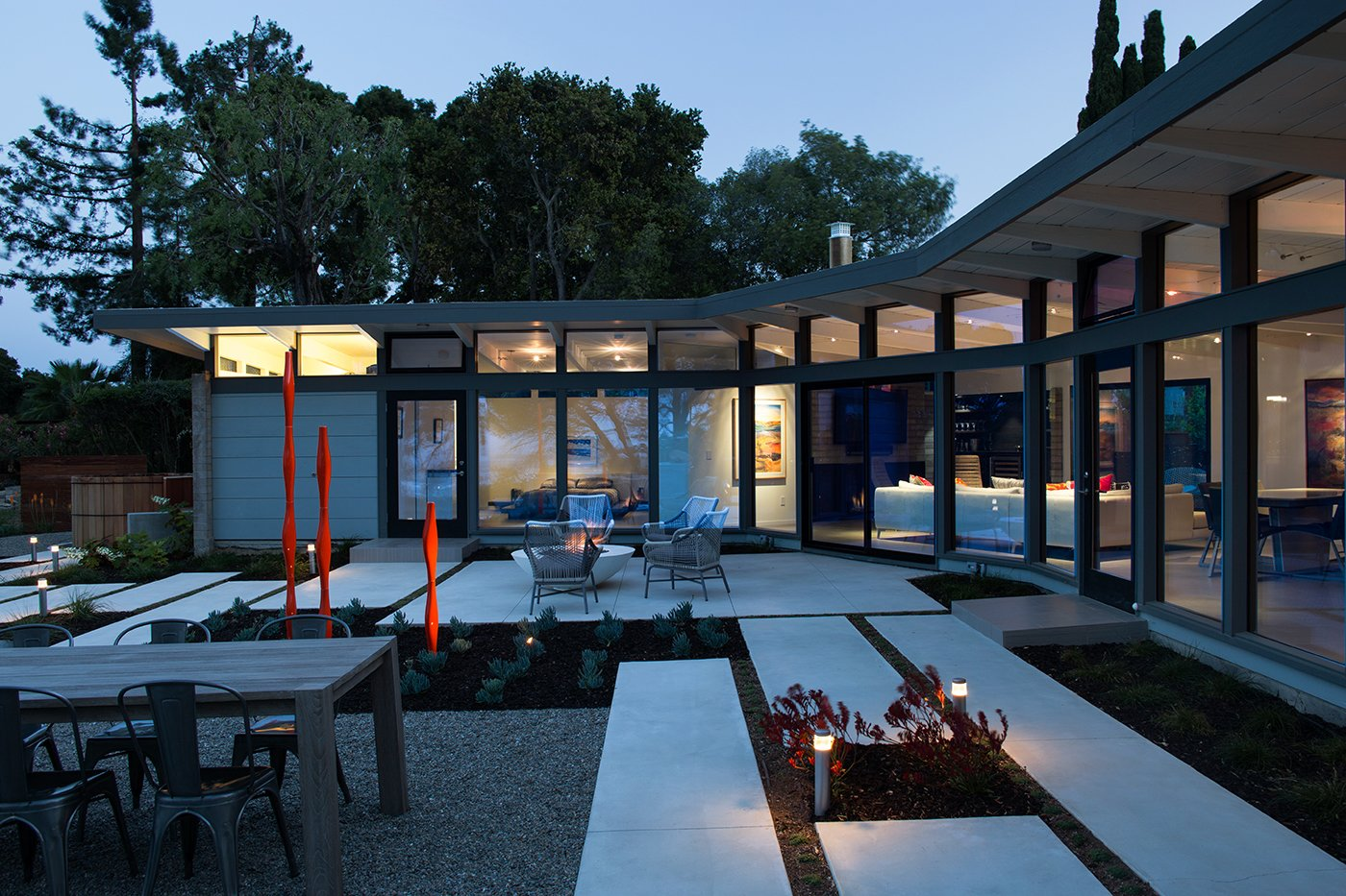 Mid Century Modern View House   Klopf Architecture, Outer Space Landscape Architects, and Flegels Construction updated a classical 1950s original mid-century modern house designed by the late Frank Lloyd Wright apprentice Ellis Jacobs. Klopf Architecture pushed the original design intent to make the house more open and uniform from space to space, while improving energy efficiency, capitalizing more on the already incredible views, improving the flow of spaces, providing an outdoor living area, and ratcheting up the quality level of the home in general. The updated custom Mid-Century Modern home is a remodeled single-family house in Redwood City. This 2,000 square foot (plus garage), 3 bedroom, 2 bathroom home is located in the heart of the Silicon Valley.