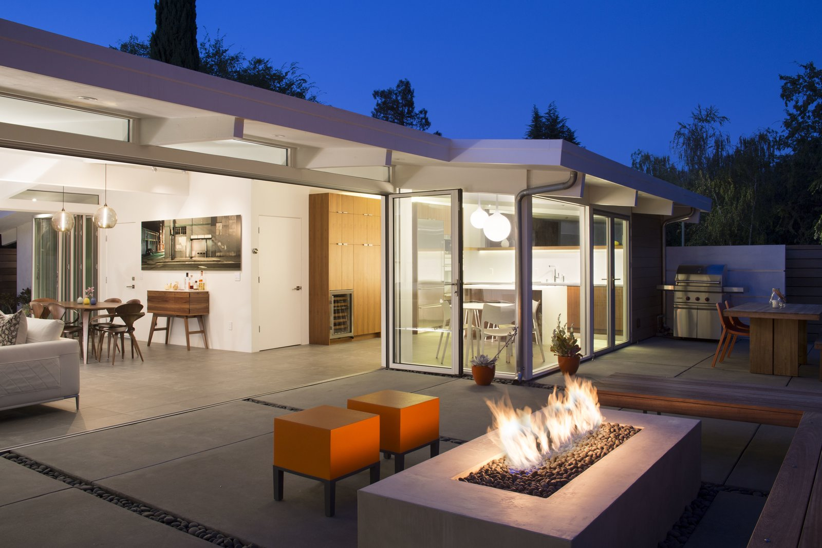 Truly Open Eichler Remodel  Klopf Architecture, Arterra Landscape Architects, and Flegels Construction updated a classic Eichler open, indoor-outdoor home. Expanding on the original walls of glass and connection to nature that is common in mid-century modern homes. The completely openable walls allow the homeowners to truly open up the living space of the house, transforming it into an open air pavilion, extending the living area outdoors to the private side yards, and taking maximum advantage of indoor-outdoor living opportunities. Taking the concept of borrowed landscape from traditional Japanese architecture, the fountain, concrete bench wall, and natural landscaping bound the indoor-outdoor space. The Truly Open Eichler is a remodeled single-family house in Palo Alto. This 1,712 square foot, 3 bedroom, 2.5 bathroom is located in the heart of the Silicon Valley.  Klopf Architecture by Klopf Architecture