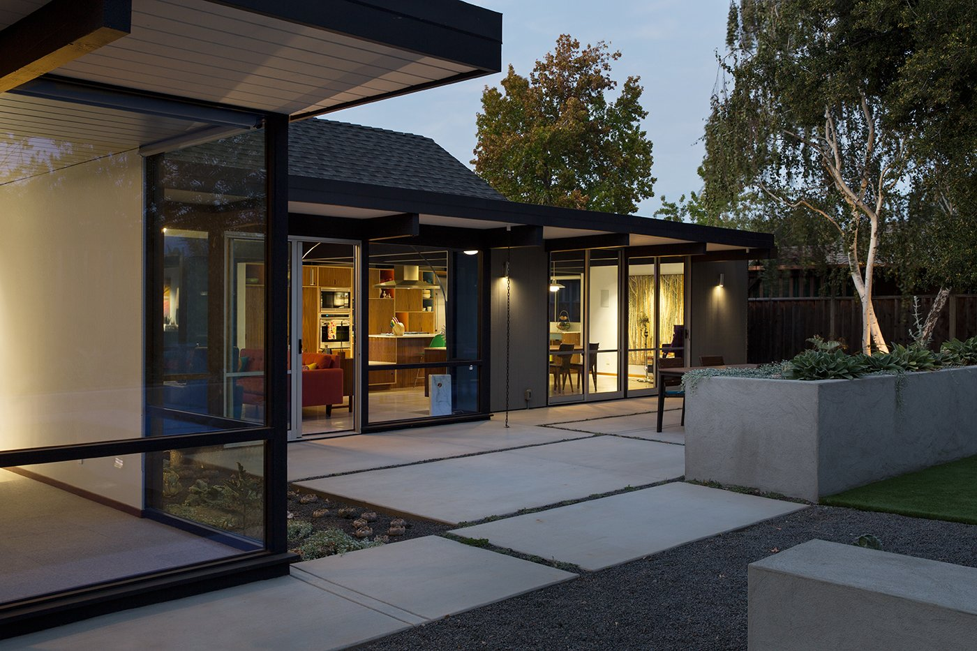 """Renewed Classic Eichler Remodel  Klopf Architecture, Growsgreen Landscape Design, and Flegel's Construction partnered to bring this mid-century atrium Eichler home up to 21st century standards. Together with the owners, Geoff Campen and the Klopf Architecture team carefully integrated elements and ideas from the mid-century period without making the space seem dated. They entrusted Klopf Architecture to respectfully expand and update the home, while still keeping it """"classic"""". The Klopf team helped them open up the kitchen, dining, and living spaces into one flowing great room, expand the master suite, replace the kitchen and bathrooms, and provide additional features like an office and powder room, all while maintaining the mid-century modern style of this Silicon Valley home.  Tagged: Exterior, Mid-Century Building Type, and House.  Klopf Architecture by Klopf Architecture"""