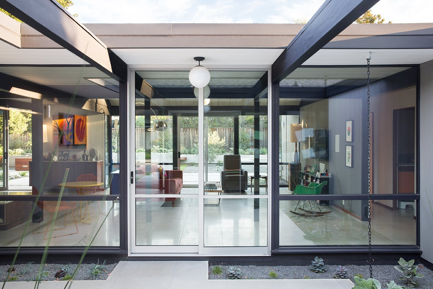 "Renewed Classic Eichler Remodel  Klopf Architecture, Growsgreen Landscape Design, and Flegel's Construction partnered to bring this mid-century atrium Eichler home up to 21st century standards. Together with the owners, Geoff Campen and the Klopf Architecture team carefully integrated elements and ideas from the mid-century period without making the space seem dated. They entrusted Klopf Architecture to respectfully expand and update the home, while still keeping it ""classic"". The Klopf team helped them open up the kitchen, dining, and living spaces into one flowing great room, expand the master suite, replace the kitchen and bathrooms, and provide additional features like an office and powder room, all while maintaining the mid-century modern style of this Silicon Valley home.   Klopf Architecture by Klopf Architecture"