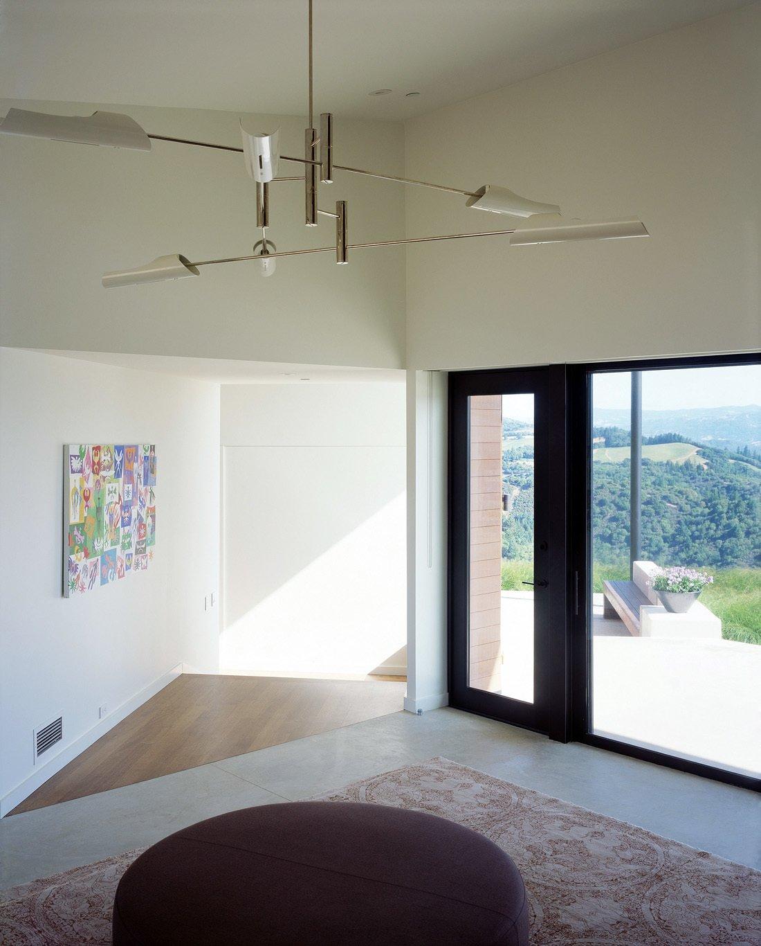 Ridge House Tagged: Hallway, Concrete Floor, and Medium Hardwood Floor.  Ridge House by Cary Bernstein Architect