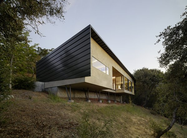 Modern home with garden, shrubs, hardscapes, walkways, raised planters, concrete patio, porch, deck, wood patio, porch, deck, slope, and outdoor. Photo 11 of Overlook Guest House