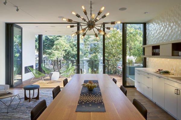 Modern home with dining room, light hardwood floor, and dark hardwood floor. Photo 3 of 29th Street Residence