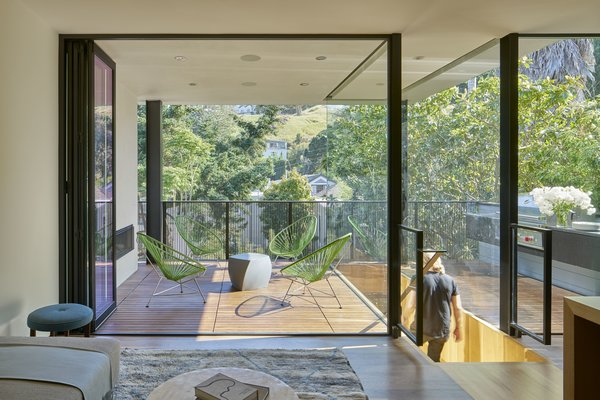 Modern home with outdoor, wood patio, porch, deck, and metal fence. Photo 4 of 29th Street Residence