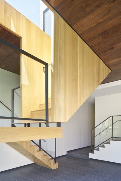Modern home with staircase, wood tread, metal railing, and glass railing. Photo 6 of 29th Street Residence