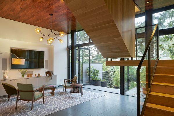 Modern home with living room, chair, end tables, pendant lighting, and floor lighting. Photo 8 of 29th Street Residence