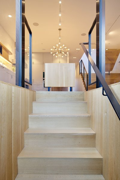 Modern home with staircase, wood tread, and metal railing. Photo 10 of 29th Street Residence