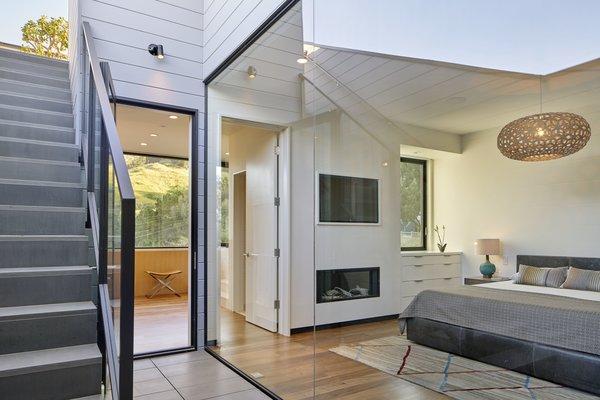 Modern home with bedroom, bed, pendant lighting, and medium hardwood floor. Photo 16 of 29th Street Residence