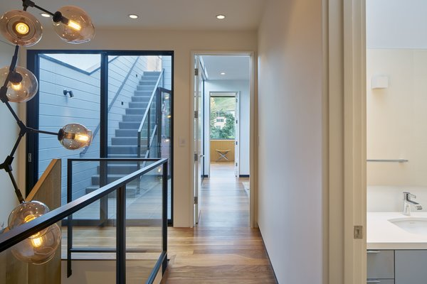 Modern home with hallway. Photo 17 of 29th Street Residence