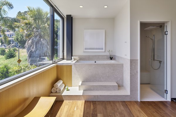 Modern home with bath room, medium hardwood floor, drop in tub, soaking tub, enclosed shower, corner shower, full shower, and recessed lighting. Photo 20 of 29th Street Residence