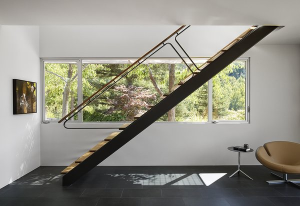 Modern home with staircase, metal railing, wood railing, and wood tread. Photo 7 of Shou Sugi Ban House