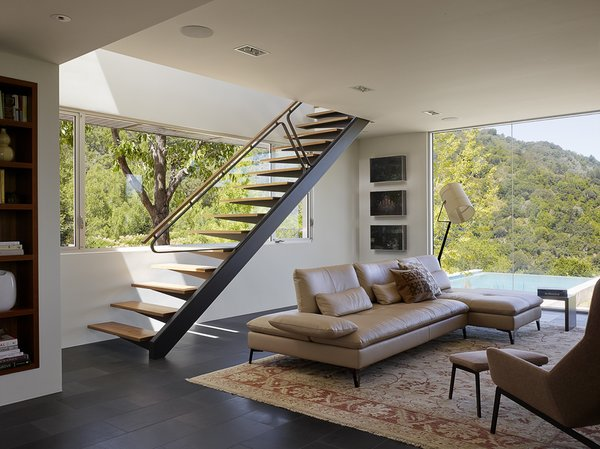 Modern home with staircase, wood tread, wood railing, and metal railing. Photo 8 of Shou Sugi Ban House