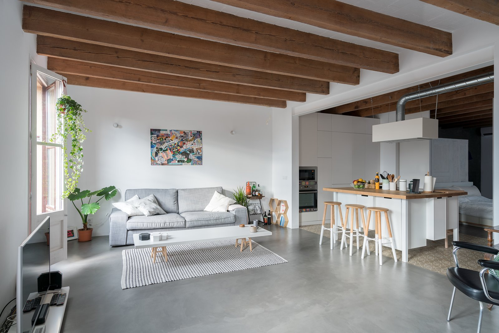 Living Room Tagged: White Cabinet, Chair, Concrete Floor, Porcelain Tile Floor, Wood Counter, Living Room, Sofa, and Coffee Tables.  Old Town Refurbishment by Habitan Architects