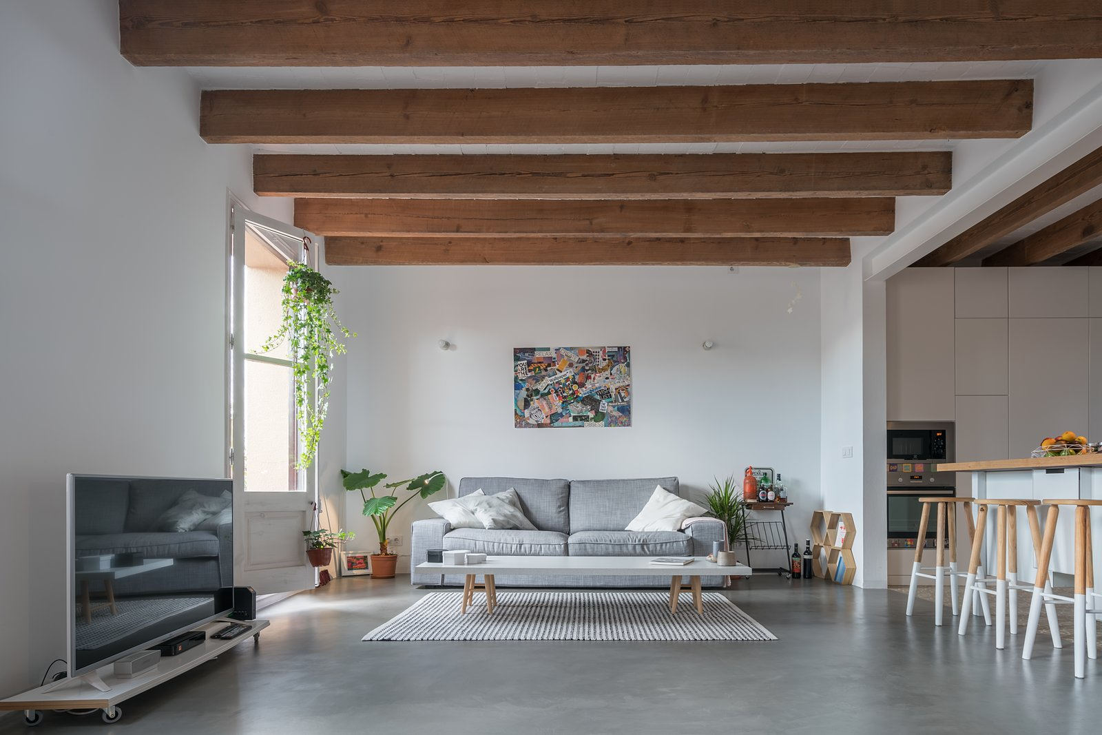 Tagged: Living Room, Sofa, Chair, Coffee Tables, and Concrete Floor.  Old Town Refurbishment by Habitan Architects