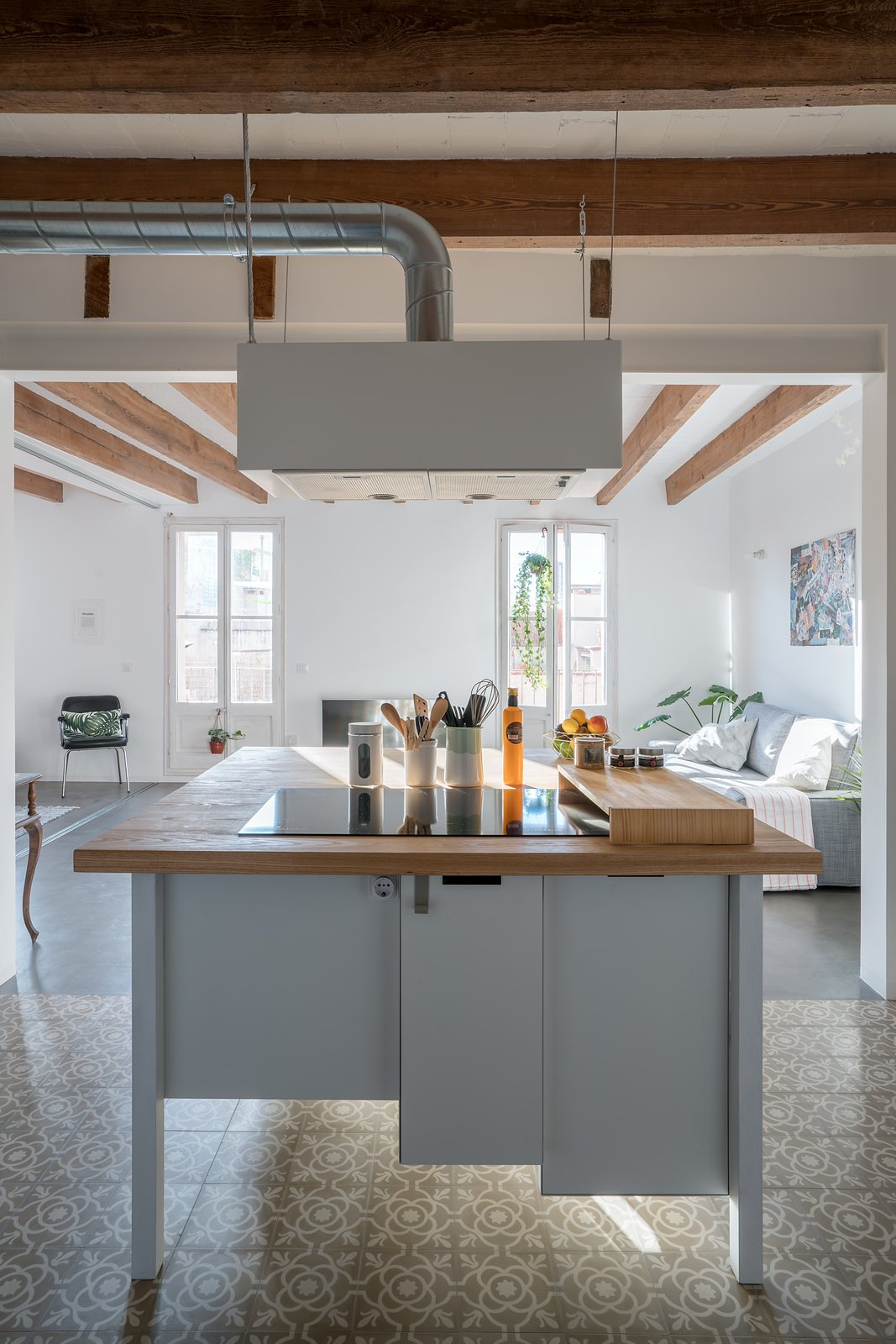 Kitchen Table Tagged: Kitchen, Ceramic Tile Floor, Wood Counter, and White Cabinet.  Old Town Refurbishment by Habitan Architects