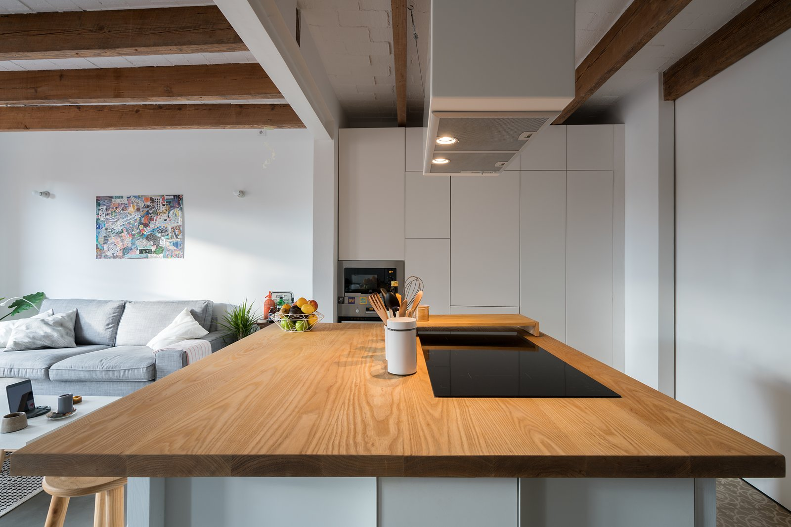 Kitchen Table Tagged: Kitchen, Ceramic Tile Floor, White Cabinet, Wood Cabinet, and Wood Counter.  Old Town Refurbishment by Habitan Architects