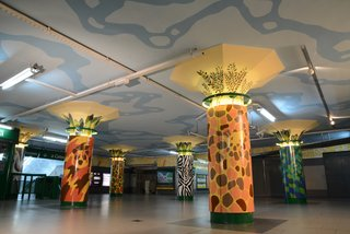 Discover One of the Most Colorful Streets in Buenos Aires - Photo 7 of 7 - Santa Maria painted the zoo-inspired columns in the entrance of the Plaza Italia subway station. Intricate tile work at the top of each column features various types of foliage.
