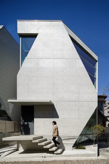 25 Modern Homes That Kill it With Concrete - Photo 18 of 25 - Built with specially-formulated concrete made of volcanic ash, this micro-house in Tokyo maximizes space through vertical construction.  When Tokyo-based architecture firm Atelier TEKUTO received a brief from their clients to build a distinctive, environmentally-conscious concrete home, they embarked on a two-and-a-half year journey of spacial and material exploration. Built in 2015, the result—the R Torso C project—recently won the Overall Excellence Award and first place in the low-rise buildings category at the 2017 American Concrete Institute Awards.