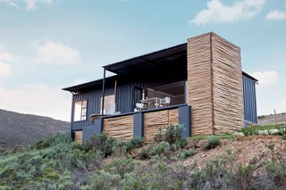 Dwell's Top 10 Upcycled Shipping Containers of 2017 - Photo 2 of 10 - Nestled on a family farm, this South African shipping container cabin is completely off the grid.<br>Located on owner Lucas Steyn's family farm in Botrivier, a 90-minute drive from Capetown, Copia is an eco-retreat comprised of two shipping container cabins in the South African countryside.