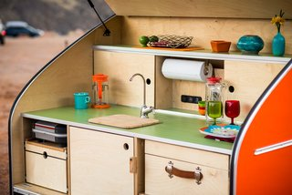 Get Your Glamp On in This Retro Teardrop Trailer - Photo 4 of 7 - The trailer features an integrated electrical system, running water, and a custom-built cooler.