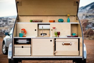 Get Your Glamp On in This Retro Teardrop Trailer - Photo 5 of 7 - The galley allows you to cook outdoors in style.