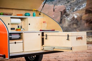Get Your Glamp On in This Retro Teardrop Trailer - Photo 6 of 7 - The birch cooler has details such as genuine leather handles and dovetail joinery.