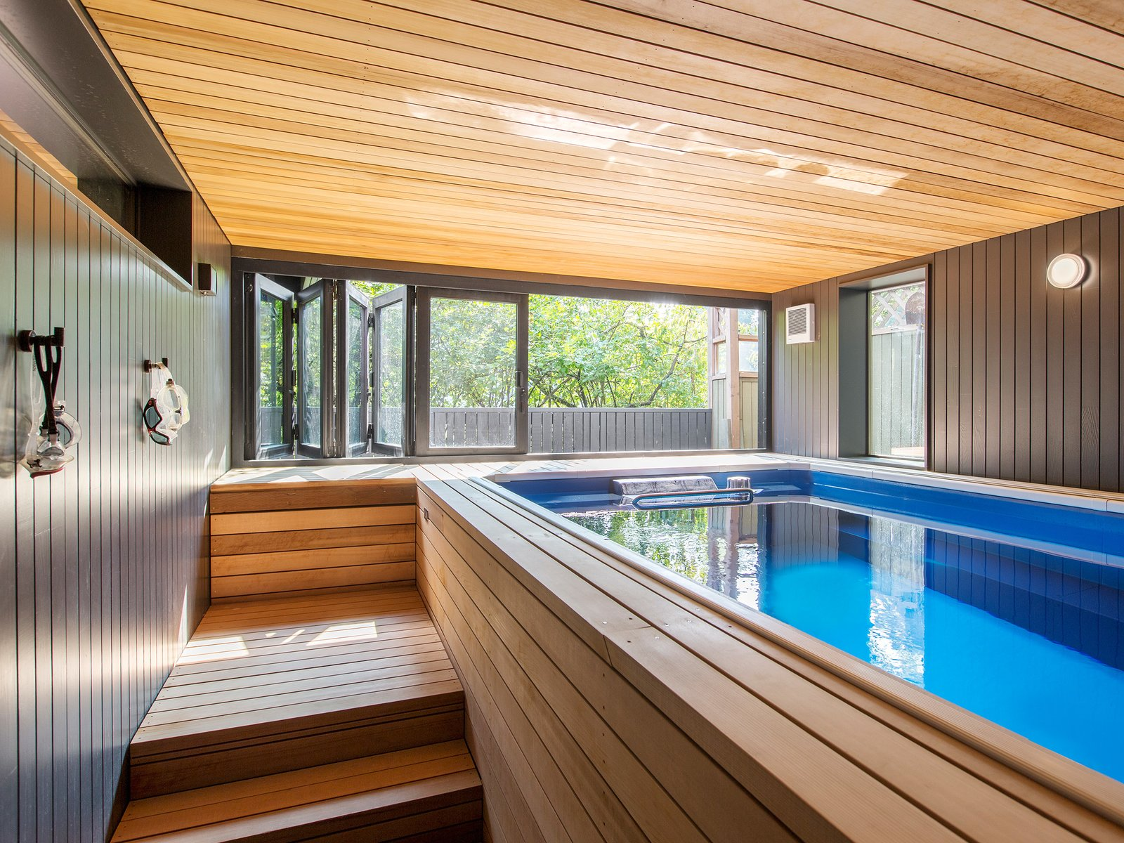 The architects transformed the old tool shed into an indoor lap pool.  Tagged: Garage and Garage Conversion.  Best Garage Photos from Hillside Midcentury