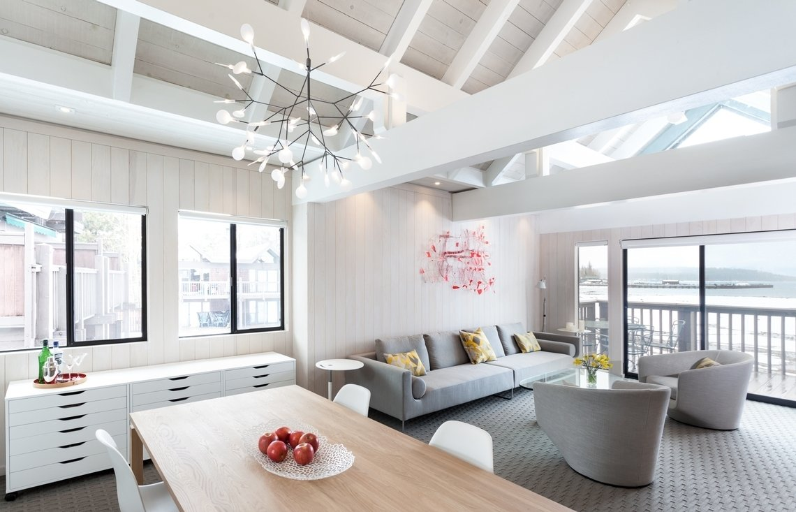 Living Tagged: Bed, Table, Carpet Floor, Chair, Night Stands, White Cabinet, Ceramic Tile Backsplashe, Pendant Lighting, and Living Room.  Tahoe Lakefront by Popp Littrell Architecture + Interiors