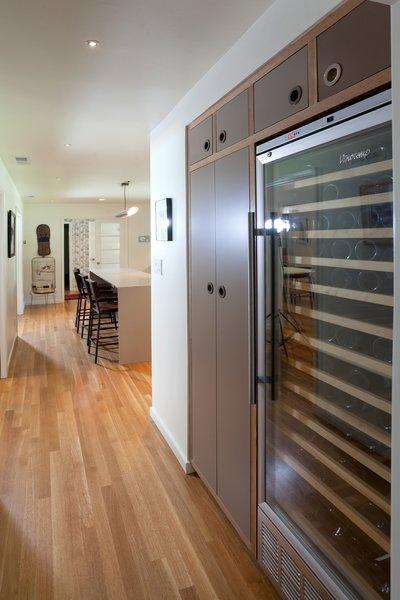 Modern home with pendant lighting, light hardwood floor, recessed lighting, refrigerator, dishwasher, wine cooler, and kitchen. Kitchen Photo 4 of Birchwood