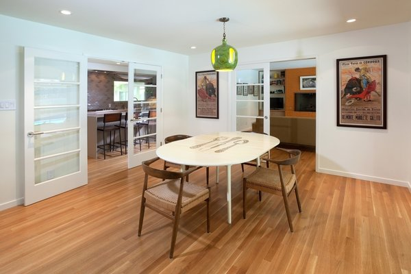 Modern home with wine cooler, coffee tables, sofa, wood burning fireplace, standard layout fireplace, and kitchen. Dining Photo 7 of Birchwood