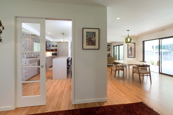 Modern home with sofa, coffee tables, table, chair, and living room. Kitchen/dining Photo 9 of Birchwood